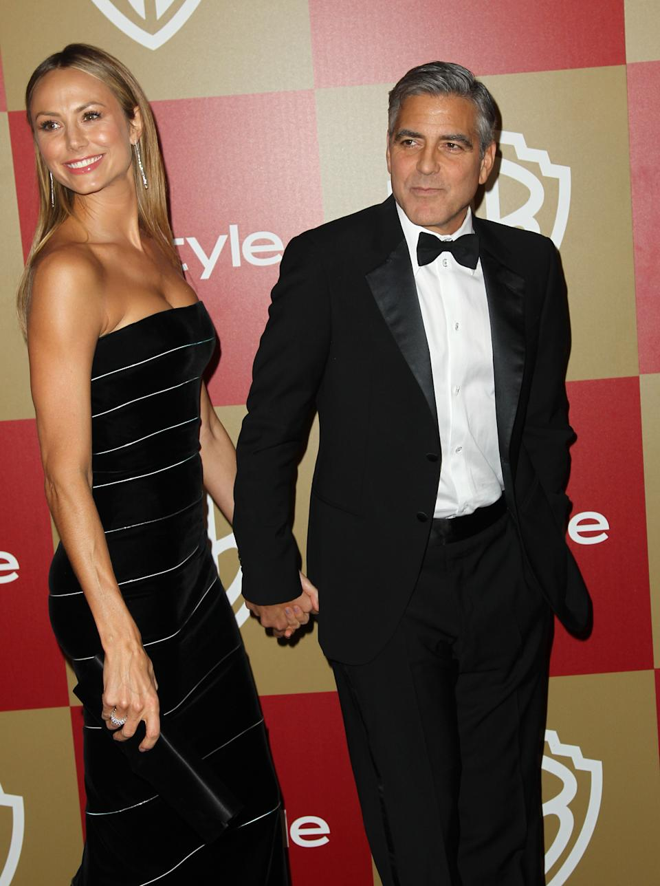 Stacy Keibler, left, and George Clooney arrive at the InStyle and Warner Bros. Golden Globe After Party at the Beverly Hilton Hotel on Sunday Jan. 13, 2013, in Beverly Hills, Calif. (Photo by Matt Sayles/Invision/AP)