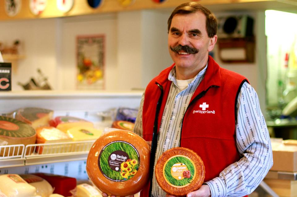 This April 19, 2013 photo shows owner Tony Zgraggen posing for a photo at the Alp and Dell artisanal cheese store in Monroe, Wis. The store is one of the few places in the area where Limburger cheese, famous for its smell, can be bought.  (AP Photo/Niamh O'Neill-Culhane)