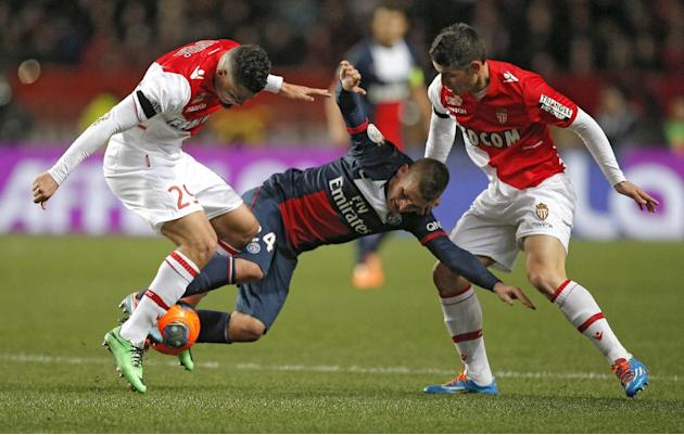 Paris Saint Germain's Marco Verratti of Italy, center, challenges for the ball with Monaco's Emmanuel Riviere of France, left, and Monaco's James Rodriguez of Colombia during their French