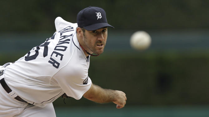 FILE - In this June 9, 2011 file photo, Detroit Tigers pitcher Justin Verlander throws a warm up pitch against the Seattle Mariners before the first inning of a baseball game in Detroit. Verlander won the AL Cy Young Award by a unanimous vote, Tuesday, Nov. 15, 2011. (AP Photo/Paul Sancya, File)