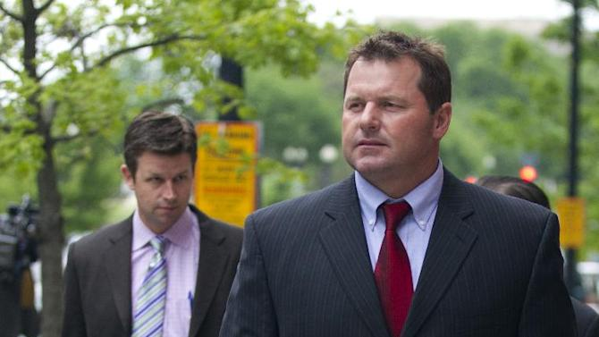 Former Major League Baseball pitcher Roger Clemens, right, leaves the Federal Court in Washington as a perjury retrial of the seven-time Cy Young Award winning pitcher entered its third week Monday, April 30, 2012.   (AP Photo/Manuel Balce Ceneta)