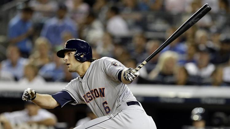 Houston Astros' Jake Marisnick (6) follows through as he hits an RBI single seventh inning of a baseball game against the New York Yankees Wednesday, Aug. 20, 2014, in New York. (AP Photo/Frank Franklin II)