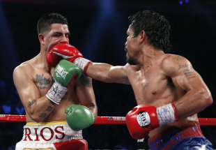 Manny Pacquiao lands a right to Brandon Rios during their WBO international welterweight title fight last year. (AP)