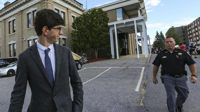 While the jury still deliberates, former St. Paul's School student Owen Labrie, left, leaves the Merrimack Superior Court at the end of day with security in tow Thursday, Aug. 27, 2015, in Concord, N.H. Labrie is charged with raping a 15-year-old freshman as part of Senior Salute, in which seniors try to romance and have intercourse with underclassmen before leaving the prestigious St. Paul's School in Concord. (AP Photo/Cheryl Senter, Pool)