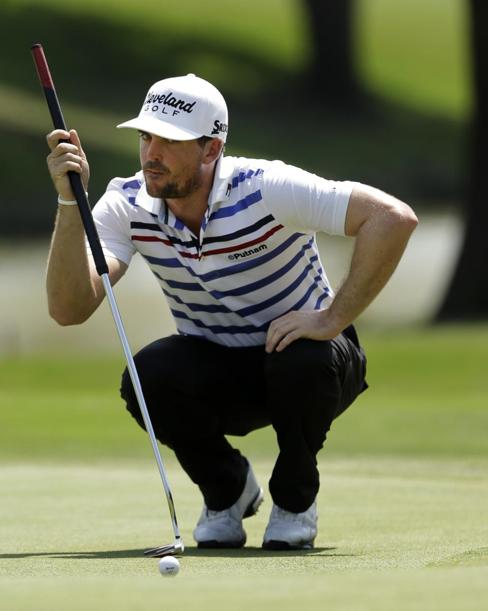 Keegan Bradley lines up his putt on the ninth green during the second round of the Byron Nelson Championship golf tournament Friday, May 17, 2013, in Irving, Texas. Bradley ended the day at 11 under par for the tournament. (AP Photo/Tony Gutierrez)