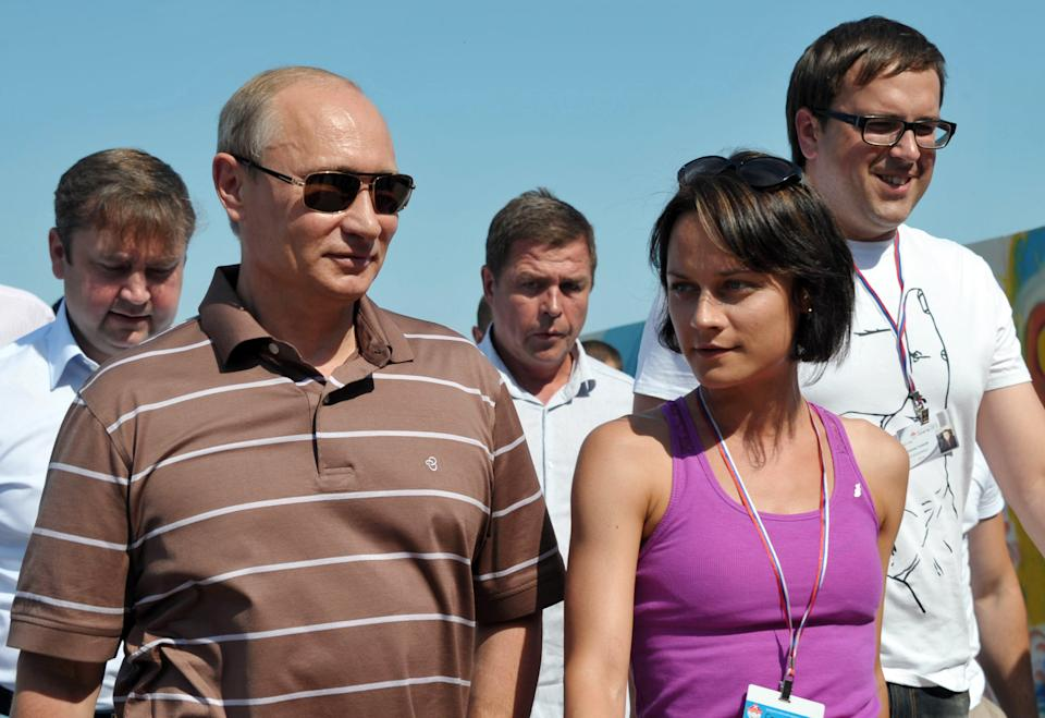 Russian President Vladimir Putin, left, walks during a meeting with pro-Kremlin youth activists at a camp at a bank of Seliger Lake in Tver region on Tuesday, July 31, 2012. (AP Photo/RIA Novosti, Alexei Nikolsky, Presidential Press Service)