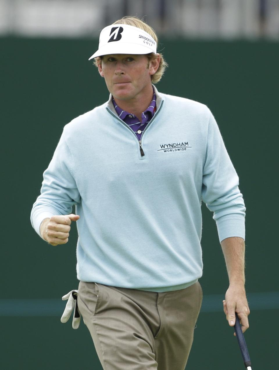 Brandt Snedeker of the United States reacts after putting on the 18th green at Royal Lytham & St Annes golf club during the second round of the British Open Golf Championship, Lytham St Annes, England, Friday, July 20, 2012. (AP Photo/Peter Morrison)