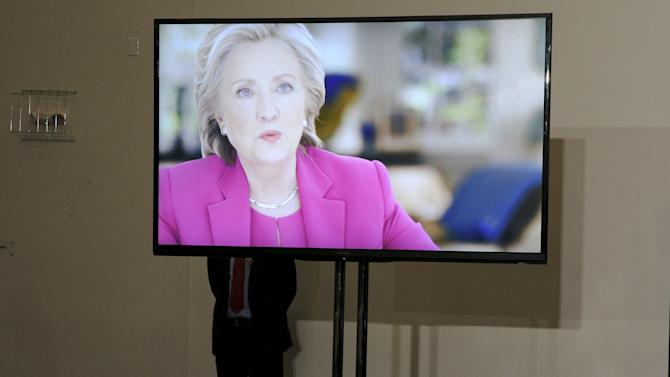 A member of the U.S. Secret Service stands behind a monitor as a video about U.S. Democratic presidential candidate Hillary Clinton plays before a campaign rally in Portsmouth