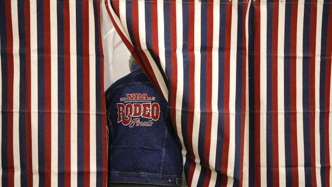 Rocky Erickson casts a ballot at a polling place on Election Day in Billings, Mont., Tuesday, Nov. 6, 2012. (AP Photo/Jae C. Hong)