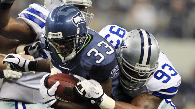 Seattle Seahawks' Leon Washington (33) is taken down by Dallas Cowboys' Anthony Spencer during the first half of an NFL football game on Sunday, Nov. 6, 2011, in Arlington, Texas. (AP Photo/Tony Gutierrez)