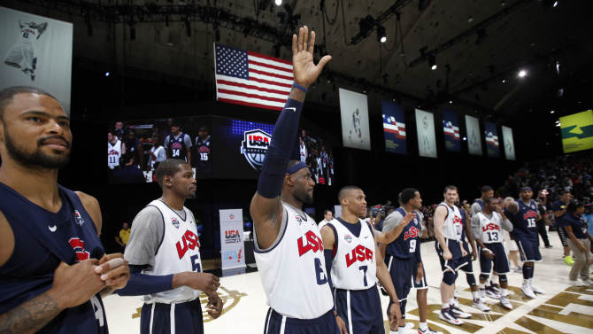 U.S. men's Olympic basketball team members, from left, Tyson Chandler, Kevin Durant, LeBron James, Russell Westbrook, Andre Iguodala, Kevin Love, Chris Paul, Carmelo Anthony and others, stand on the court before a practice Saturday, July 14, 2012, in Washington. (AP Photo/Alex Brandon)