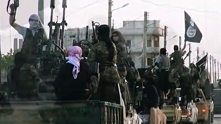 An image grab taken from a propaganda video released on March 17, 2014 by the Islamic State of Iraq and the Levant's al-Furqan Media allegedly shows ISIL fighters in Homs