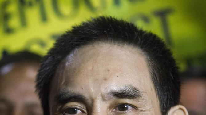 Human rights activist Nguyen Quoc Quan speaks during a press conference after his arrival at the Los Angeles International Airport from Vietnam on Wednesday, Jan. 30, 2013, in Los Angeles.  Quan has been released after being detained since April 17, 2012 in Ho Chi Minh City, Vietnam. (AP Photo/Ringo H.W. Chiu)