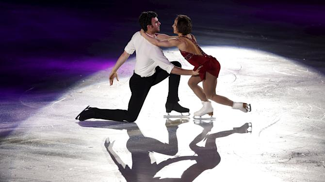 Duhamel and Radford of Canada perform during the exhibition program at the ISU World Team Trophy in Figure Skating in Tokyo