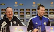 Chelsea's interim manager Rafael Benitez (L) and goalkeeper Petr Cech attend a press conference, on February 13, 2013. Defending European champions Chelsea infamously made history when they became the first Champions League title-holders to exit the competition in the group stage