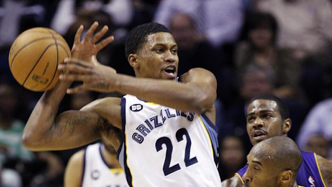 Los Angeles Lakers' Kobe Bryant, right, knocks the ball away form Memphis Grizzlies' Rudy Gay (22) during the first half of an NBA basketball game in Memphis, Tenn., Wednesday, Jan. 23, 2013. (AP Photo/Daniel Johnston)