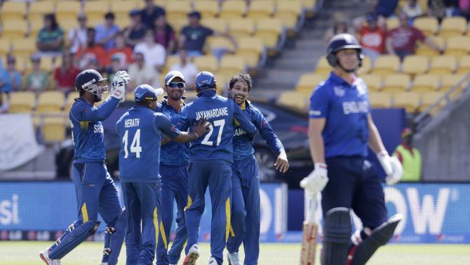 Teammates congratulate Sri Lanka's Dilshan after he took the wicket of England's Ballance during their Cricket World Cup match in Wellington