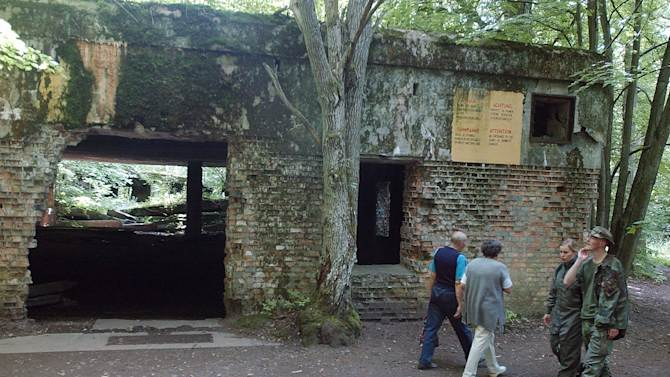 "FILE - In this July 17, 2004 file photo tourists visit the ruins of Adolf Hitler's headquarters the ""Wolf's Lair"" in Gierloz, northeastern Poland, where his chief of staff members made an unsuccessful attempt at Hitler's life on July 20, 1944. Margot Woelk was one of 15 young women who sampled Hitler's food to make sure it wasn't poisoned before it was served to the Nazi leader in his ""Wolf's Lair,"" the heavily guarded command center in what is now Poland, where he spent much of his time in the final years of World War II. Margot Woelk kept her secret hidden from the world, even from her husband then, a few months after her 95th birthday, she revealed the truth about her wartime role. (AP Photo/Czarek Sokolowski, File)"