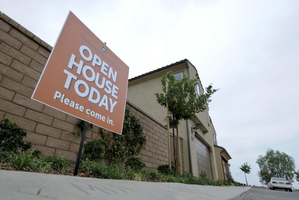In this Sept. 25, 2011 photo, a for sale is posted near new homes for sale in the Blackstone development in Brea, Calif. Sales of new homes fell to a six-month low in August. The fourth straight monthly decline during the peak buying season suggests the housing market is years away from a recovery.(AP Photo/Chris Carlson)