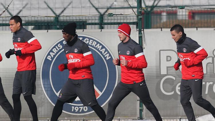 David Beckham is seen with his teammates during a practice session with Paris Saint-Germain soccer team in Saint-Germain-en-Laye, west of Paris, Wednesday, Feb. 13, 2013. David Beckham started his first practice session with Paris Saint-Germain on Wednesday amid a media frenzy as dozens of camera crews and photographers jostled for position at the club's training ground in the western suburbs of Paris. (AP Photo/Michel Euler)