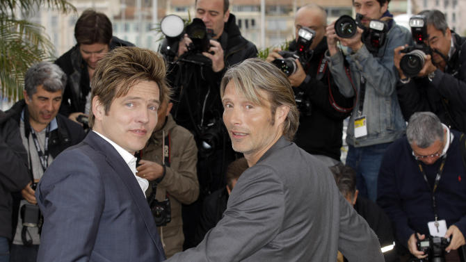 Director Thomas Vinterberg, left, and actor Mads Mikkelsen pose during a photo call for The Hunt at the 65th international film festival, in Cannes, southern France, Sunday, May 20, 2012. (AP Photo/Lionel Cironneau)