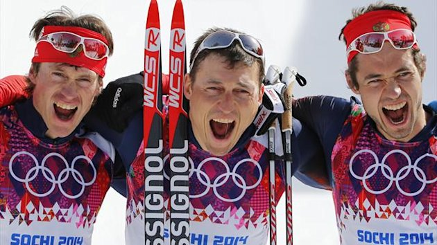 Russia's Maxim Vylegzhanin, Alexander Legkov and Ilia Chernousov (L-R) celebrate after winning the men's cross-country 50 km mass start free event at the Sochi 2014 Winter Olympic Games February 23, 2014 (Reuters)