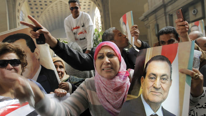 Egyptians supporters of ousted former President Hosni Mubarak celebrate an appeal granted by a court, in Cairo, Egypt, Sunday, Jan. 13, 2013. A court granted Hosni Mubarak's appeal of his life sentence in a Sunday, Jan. 13, 2013 hearing, ordering a retrial of the ousted Egyptian president on charges that he failed to prevent the killing of hundreds of protesters during the uprising that toppled his regime nearly two years ago. The ruling came one day after a prosecutor placed a new detention order on Mubarak over gifts worth millions of Egyptian pounds (hundreds of thousands of US dollars) he and other regime officials allegedly received from Egypt's top newspaper as a show of loyalty while he was in power. (AP Photo/Amr Nabil)