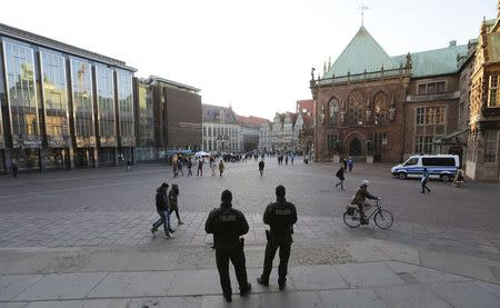 Armed police officers guard 'St. Petri Dome,' next to the town hall of the northern German city Bremen