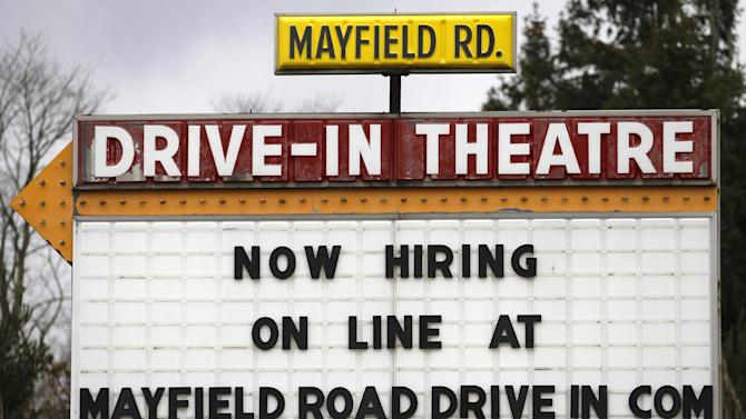 In this Thursday, March 8, 2012 photo, a help-wanted sign displays outside the Mayfield Drive-In movie theater in Chardon, Ohio. U.S. employers added 227,000 jobs in February to complete three of the best months of hiring since the recession began. The unemployment rate was unchanged, largely because more people streamed into the work force. The Labor Department said Friday, March 9, 2012, that the unemployment rate stayed at 8.3 percent last month, the lowest in three years. (AP Photo/Amy Sancetta)