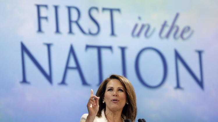 Republican presidential candidate Rep. Michele Bachmann, R-Minn., speaks to supporters gathered for the Iowa Republican Party's Straw Poll, Saturday, Aug. 13, 2011, in Ames, Iowa. (AP Photo/Charlie Neibergall)