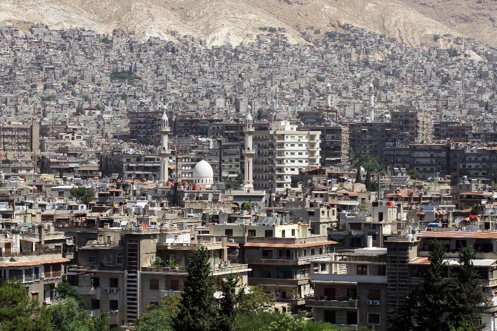 Battling rebels, IS moves closer to central Damascus: monitor