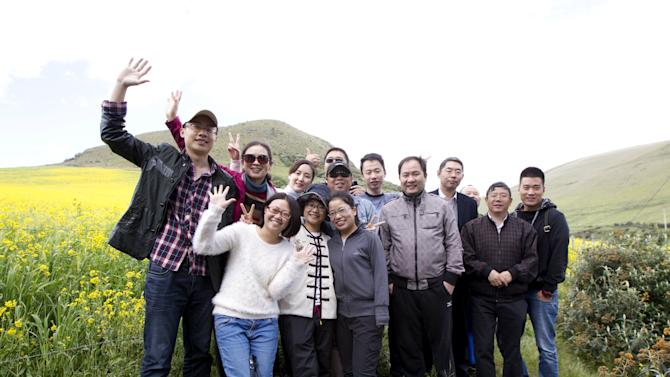 Chinese tourists pose for a photo at the Antisana National Park in Pintag, Ecuador