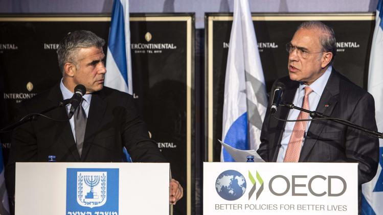 Gurria speaks during a news conference with Lapid in Tel Aviv