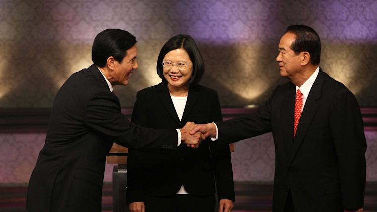 Taiwan's presidential candidates, ruling Nationalist Party's President Ma Ying-jeou, left, Democratic Progressive Party's Tsai Ing-wen, and People First Party's James Soong greet before their presidential debate at Taiwan Public Television Service in Taipei, Taiwan, Saturday, Dec. 3. 2011. (AP Photo/ Aden Hsu, Pool)