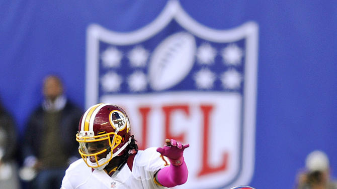 Washington Redskins quarterback Robert Griffin III (10) is sacked by New York Giants defensive end Jason Pierre-Paul (90) during the second half of an NFL football game, Sunday, Oct. 21, 2012, in East Rutherford, N.J. (AP Photo/Bill Kostroun)