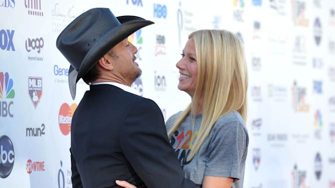 "Musician Tim McGraw, left, embraces actress Gwyneth Paltrow at ""Stand Up to Cancer"" at the Shrine Auditorium on Friday, Sept. 7, 2012 in Los Angeles. The initiative aimed to raise funds to accelerate innovative cancer research by bringing new therapies to patients quickly. McGraw and Paltrow starred as a married couple in the film ""Country Strong.""  Paltrow's father Bruce died from cancer in 2002. (Photo by John Shearer/Invision/AP)"