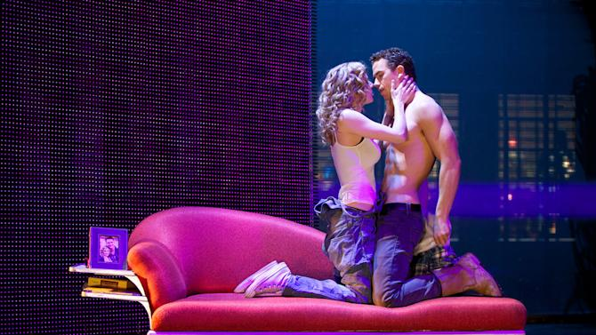 """In this theater image released by The Hartman Group, Caissie Levy, left, and Richard Fleeshman are shown in a scene from """"Ghost The Musical,"""" at the at the Lunt-Fontanne Theatre in New York. (AP Photo/The Hartman Group, Joan Marcus)"""