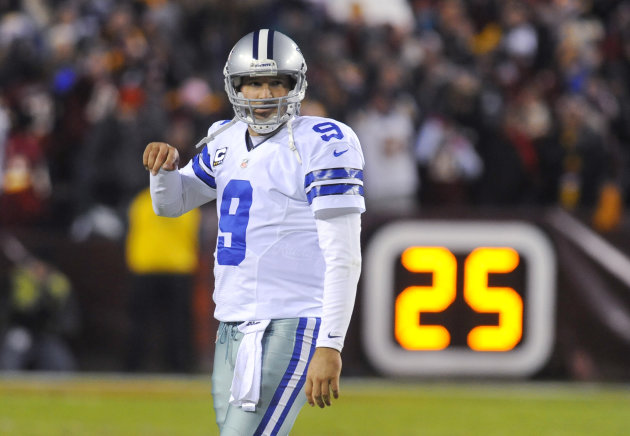Dallas Cowboys quarterback Tony Romo reacts after throwing his second interception during the first half of an NFL football game against the Washington Redskins, Sunday, Dec. 30, 2012, in Landover, Md