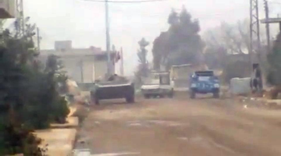 In this image from amateur video made available by the Ugarit News group on Wednesday, Dec. 21, 2011, purports to show military vehicles in Homs, Syria. (AP Photo/Ugarit News Group via APTN) THE ASSOCIATED PRESS CANNOT INDEPENDENTLY VERIFY THE CONTENT, DATE, LOCATION OR AUTHENTICITY OF THIS MATERIAL, TV OUT