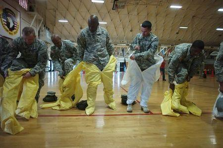 US Army soldiers from the 101st Airborne Division, who are earmarked for the fight against Ebola, conduct training before their deployment to West Africa, at Fort Campbell