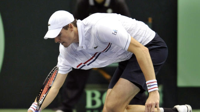 USA's John Isner can't get to the ball in the first match of the day against Brazil's Thomaz Bellucci during the 2013 World Group First Round of the Davis Cup Sunday Feb. 3, 2013 at Veterans Memorial Arena in Jacksonville, Fla.   (AP Photo/The Florida Times-Union, Will Dickey)