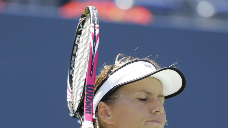 Varvara Lepchenko reacts during her match against Samantha Stosur, of Australia, in the third round of play at the 2012 US Open tennis tournament,  Friday, Aug. 31, 2012, in New York. (AP Photo/Mike Groll)