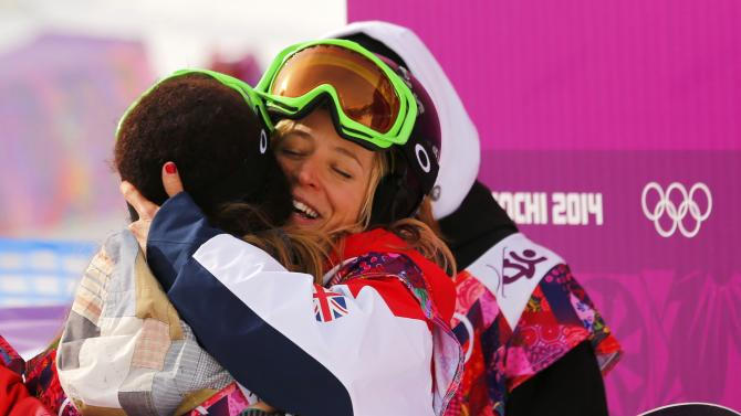 Jamie Anderson of U.S. hugs Britain's Jenny Jones after women's slopestyle snowboarding competition at the 2014 Sochi Olympic Games in Rosa Khutor