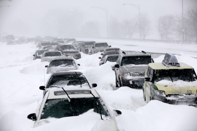 FILE - In this Feb. 2, 2011 file photo, hundreds of cars are seen stranded on Lake Shore Drive in Chicago after a winter blizzard of historic proportions wobbled an otherwise snow-tough Chicago. America&#39;s wild weather year has hit yet another new high: a devastating dozen billion-dollar catastrophes. The National Oceanic and Atmospheric Administration announced Wednesday that it has recalculated the number of weather disasters passing the billion dollar mark, with two new ones, pushing 2011&#39;s total to 12. The two costly additions are the Texas, New Mexico and Arizona wildfires and the mid June tornadoes and severe weather. (AP Photo/Kiichiro Sato, File)