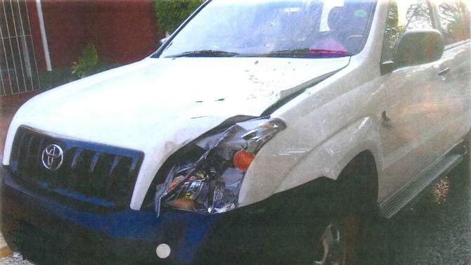 """This image released by U.S. District Court in Alexandria, Va.,  shows the damage to the car that allegedly hit and killed Alois Pedzisai Matyoramhinga in Zimbawbe. Unusual circumstances have left federal prosecutors pursuing vandalism charges against Andrew Pastirik, a U.S. government worker accused of killing the Zimbabwe man in a drunken driving collision. Much of the case against Pastirik is shrouded in secrecy at a federal courthouse in northern Virginia. Court documents show the only charge filed against Pastirik in the 2008 death is one of """"malicious mischief,"""" or vandalism, for wrecking a U.S. government-owned Toyota Land Cruiser he was driving. (AP Photo/Department of Justice)"""