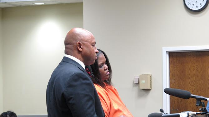 Shaquan Duley, right and her lawyer, Carl B. Grant, left, stand before a judge as she is sentenced in Orangeburg, S.C. on Friday, March 30, 2012. Duley was sentenced to 35 years in prison on two counts of murder for suffocating her children and trying to hide the crime by sinking her car in a river. (AP Photo/Jeffrey Collins)
