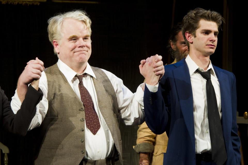"FILE - In this March 15, 2012 file photo, actors Philip Seymour Hoffman, left, and Andrew Garfield appear at the curtain call for the opening night performance of the Broadway revival of Arthur Miller's ""Death of A Salesman"" in New York. (AP Photo/Charles Sykes, file)"