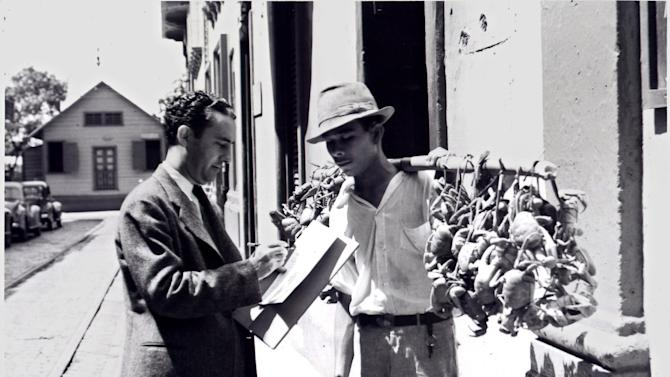In this 1940 photo provided by the U.S. Census Bureau, an enumerator collects data from a street vendor carrying a poll of fresh crabs in Puerto Rico. Technical issues plagued the 1940 Census website on Monday, April 2, 2012, the first day that it became available to the public but the National Archives said Tuesday, April 3, that census pages are again available for viewing. The government website got 37 million hits hours after the information was first released to the public Monday morning, all but paralyzing attempts to access details.   (AP Photo/U.S. Census Bureau)