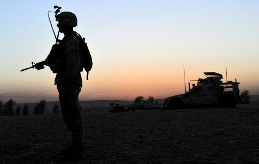 A soldier with NATO's International Security Assistance Force stands guard in the Musa Qala district of Helmand province