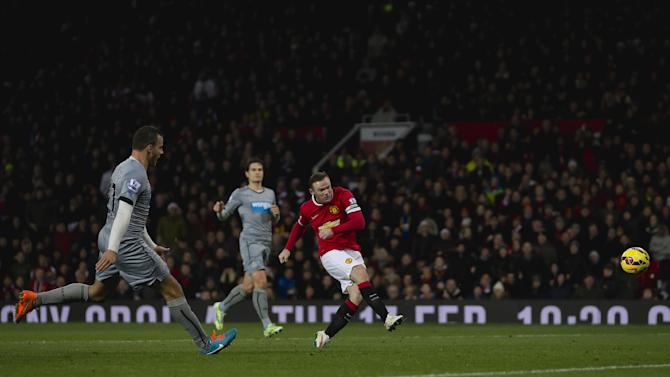 Manchester United's Wayne Rooney, right, scores his second goal against Newcastle during the English Premier League soccer match between Manchester United and Newcastle at Old Trafford Stadium, Manchester, England, Friday, Dec. 26, 2014. (AP Photo/Jon Super)